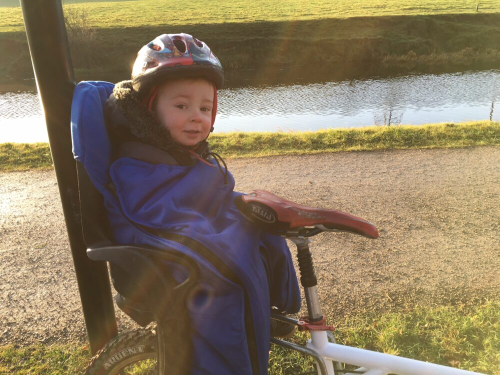 Keeping warm in a rear bike seat with the Huby Muffle