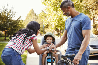 Getting your child ready to use a rear bike seat - strapping them in