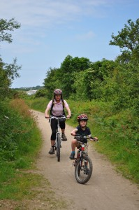 hiring bikes for the family - riding with mum