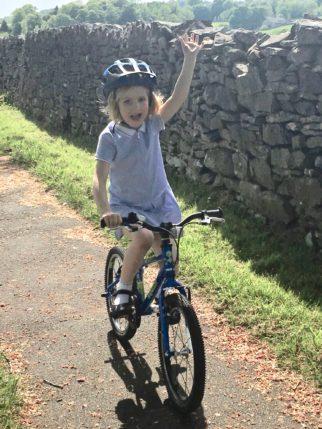 Katherine on Squish Bike hand in air