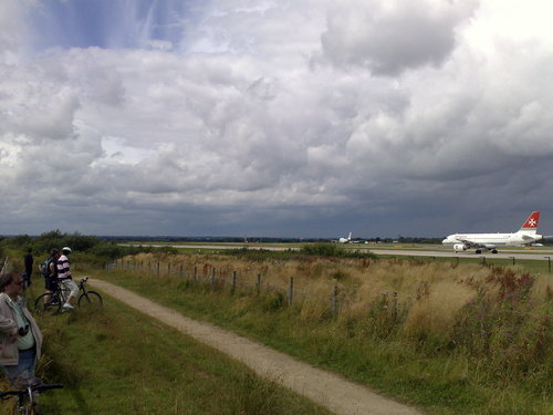 Family bike ride at Manchester Airport, cycle past the planes