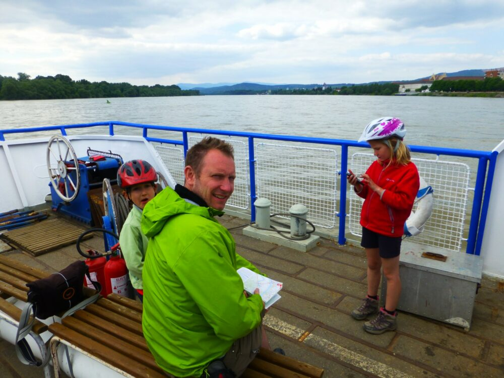 Taking the boat along the River Danube with bikes and kids on our Family cycling holiday along the River Danube from Vienna to Budapest