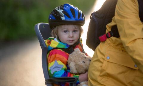Boy in rear bike seat