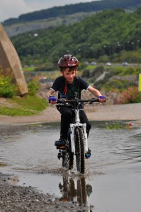 Family cycling in North Wales - Riding in puddles on the NCN5 near Rhos-on-Sea