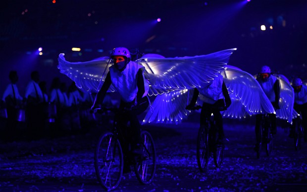 Dove bikes cycling with white wings at the London 2012 Olympic opening ceremony