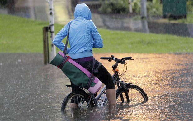 Cyclist in floodwater UK