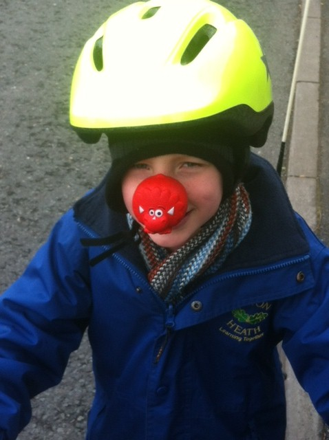 Cyclilng to school on Red Nose Day Comic Relief