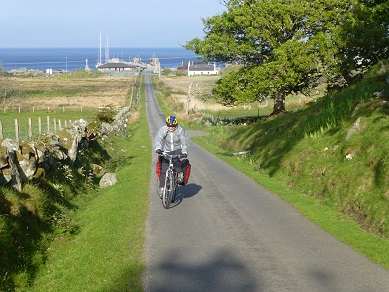 Granny riding her bike on a Scottish Islands family cycling holiday
