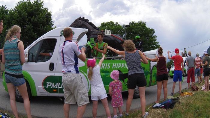 Tour de France Facts for Kids - the Tour de France caravan often throws out goodies!