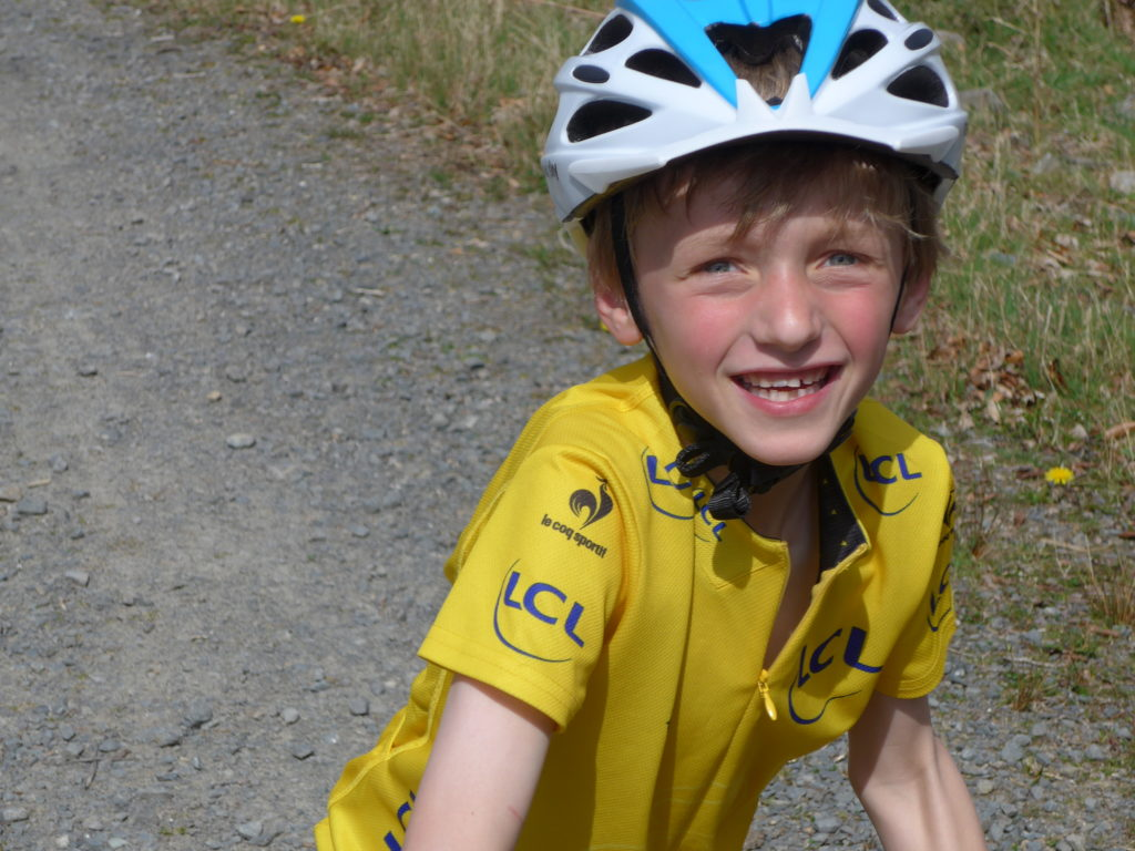 Team Sky kids cycling helmet and yellow jersey
