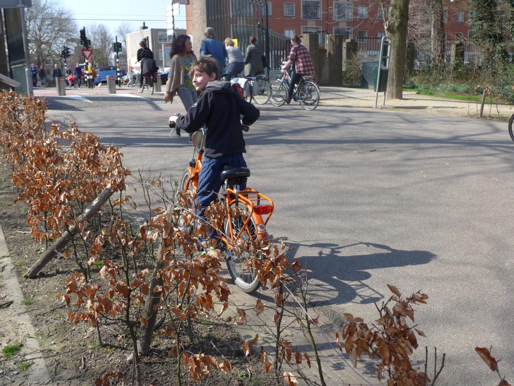Riding a kids rental bike in Vondelpark Amsterdam