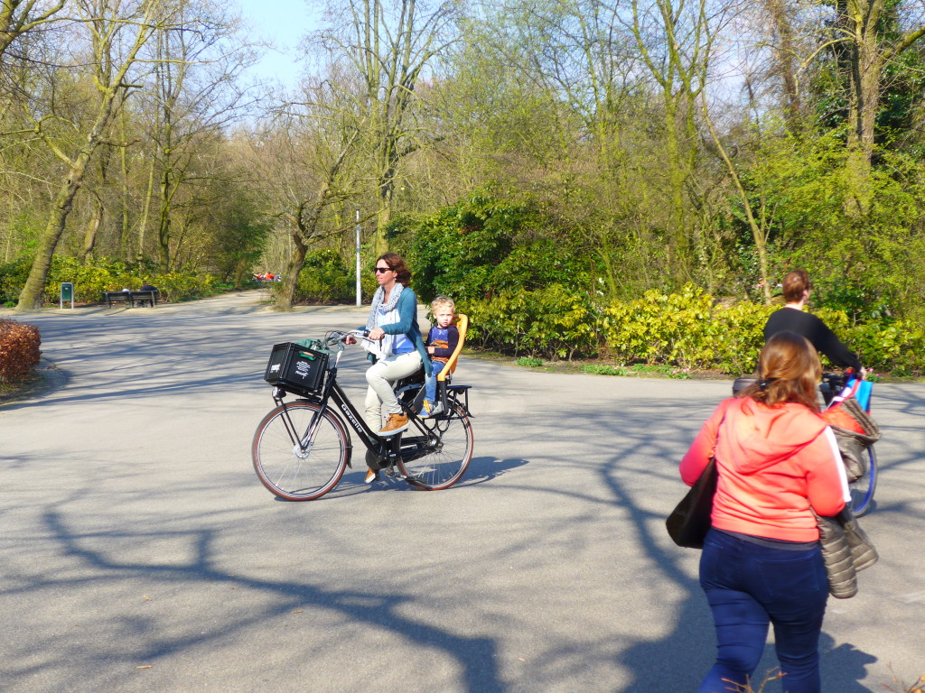 Cycling with a child in a rear bike seat in Amsterdam