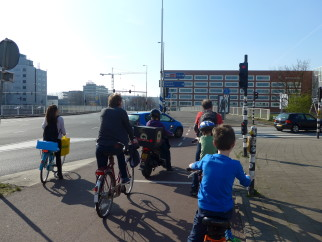 9 year old boy ycling on the segergated paths Amsterdam