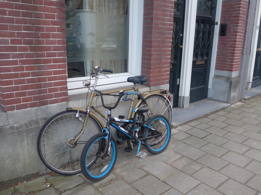 Photo of adult and kids bike in Amsterdam, Holland 2016