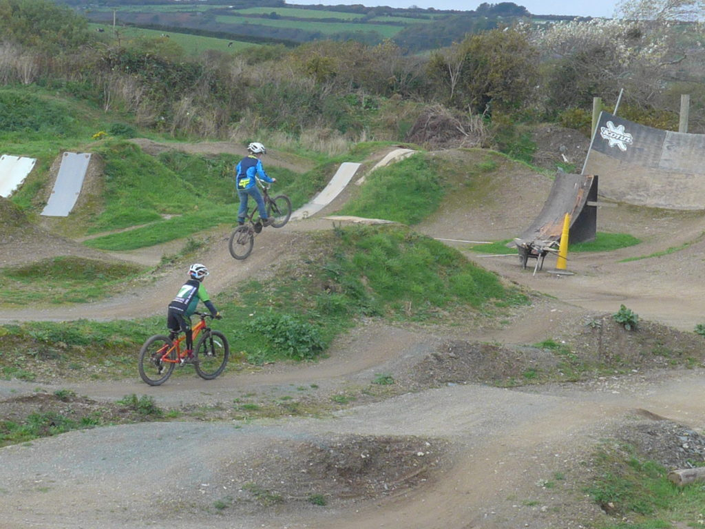 Riding the jumps at The Track Bike Park, Redruth, Cornwall