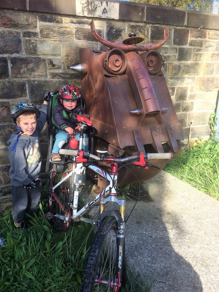 Family cycling along the Spen Valley Greenway- a disused railway in West Yorkshire