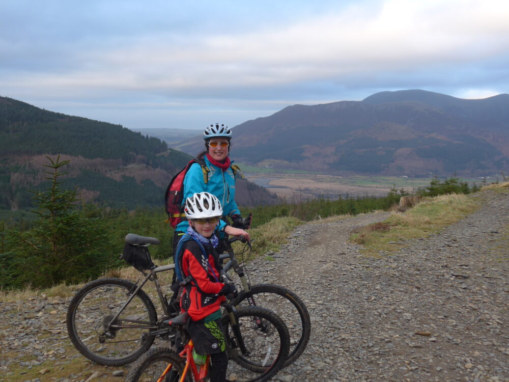 Family cycling during the winter at Whinlater Forest, Cumbria