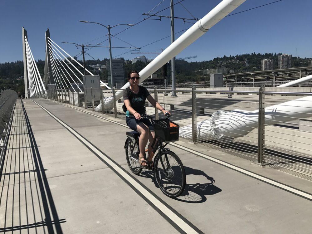 Karen riding across the Tilikum Crossing Portland