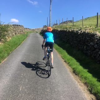 Polaris Mini cycling top in action as a road jersey