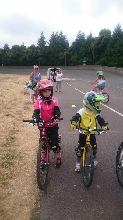 Jess and her sister at a kids BMX skills training session