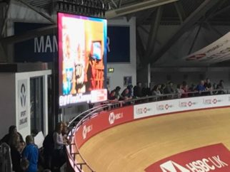 Ethan and Lucy's photo on the screen at the velodrome