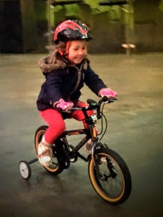 GIrls on bicycles - learning to ride a bike using stabilisers