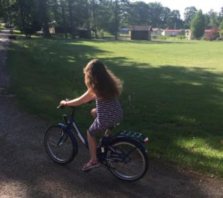Girl on a bicycle - on a summer's day