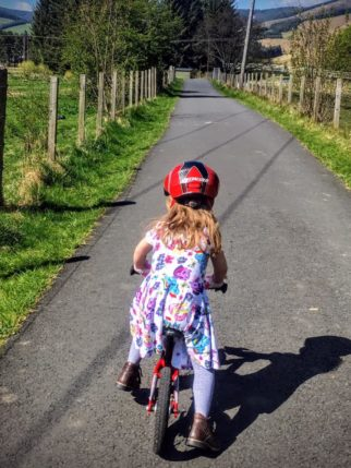 Girl on a bike - learning to ride in a dress