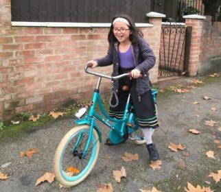 Girl on bike wearing normal clothing