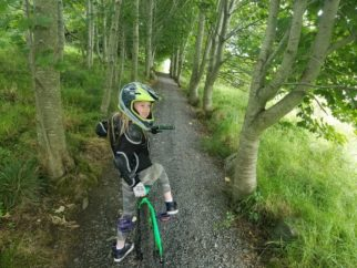 Lucy mountain biking on the Mary Peters trails in Ireland