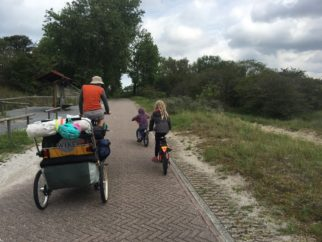 family cycling holiday to The Netherlands - trailer and two children riding bikes