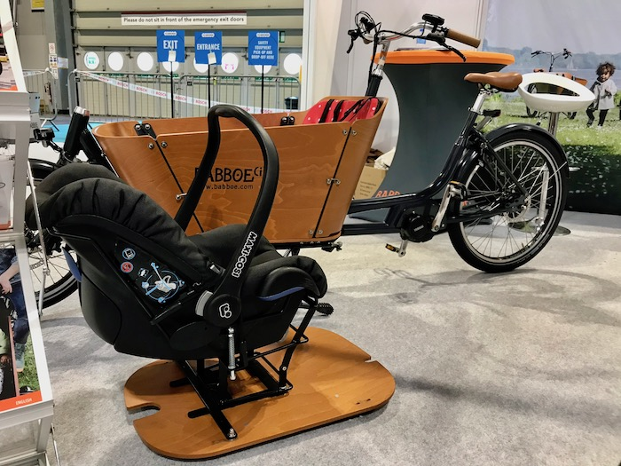 family cargo bikes at the 2019 Cycle Show - Babboe City with Maxi Cosi baby seat carrier shown alongside