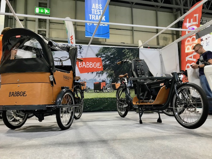 family cargo bikes at the 2019 Cycle Show - Babboe Curve shown on the left