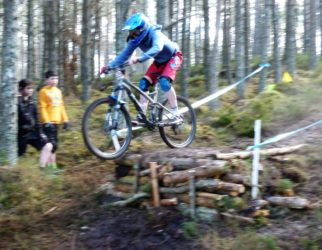 Jessica taking the drop - girl mountain biker