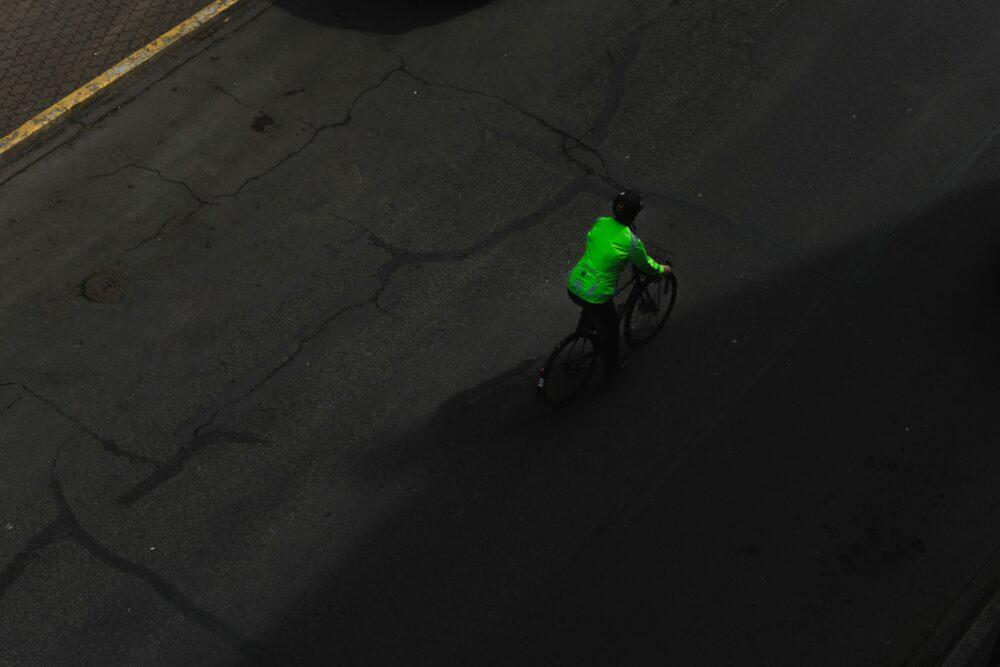 Unsplash - Sebastian Huxley - cyclist riding on pavement by themselves