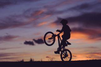 Child doing wheelie on bike