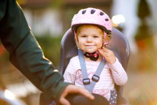 Girl in Rear Bike Seat - Adobe Stock Photo