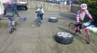Kids riding their bike on the driveway