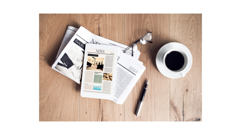 Family Cycling News - newspaper and coffee cup on table