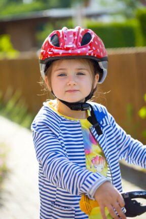 Correctly tightened kids bike helmet